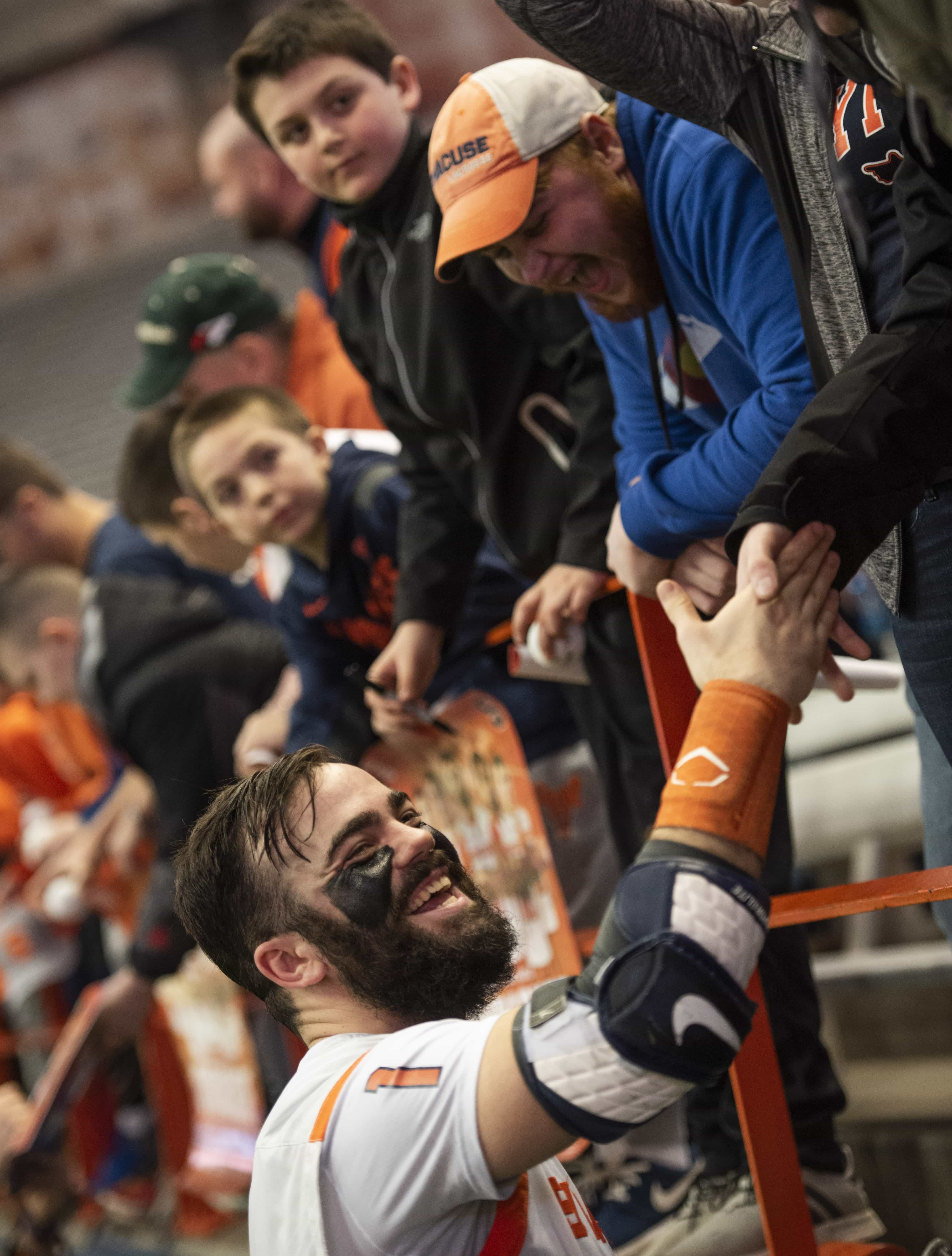 Senior Bradley Voigt shakes hands with fans after the Orange's 10-8 win over Army.