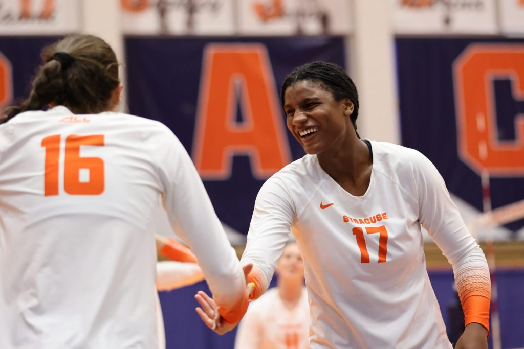 Syracuse's Naomi Franco (right) reacts after picking up Abby Casiano (left) during a volleyball match against University of Connecticut at the Women's Building on August 27, 2021.