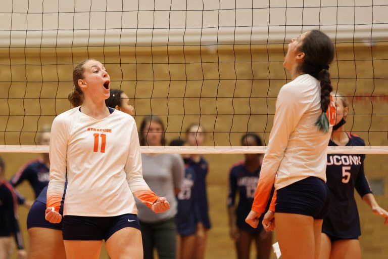 Syracuse's Polina Shemanova (left) reacts with Abby Casiano (right) after a kill against University of Connecticut at the Women's Building on August 27, 2021