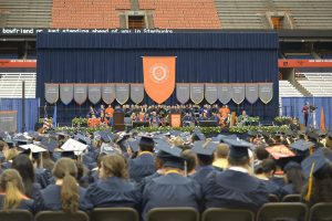 Students from Syracuse University and State University of New York College of Environmental Science and Forestry attend a commencement ceremony held on May 10, 2015 at the Carrier Dome.