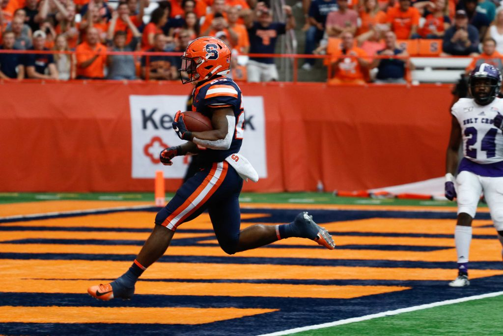 Junior Abdul Adams scores a touchdown for Syracuse in the game against The College of the Holy Cross.