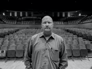 Jim Bugos, the general manager of Packard Music Hall, stands in the empty theater.