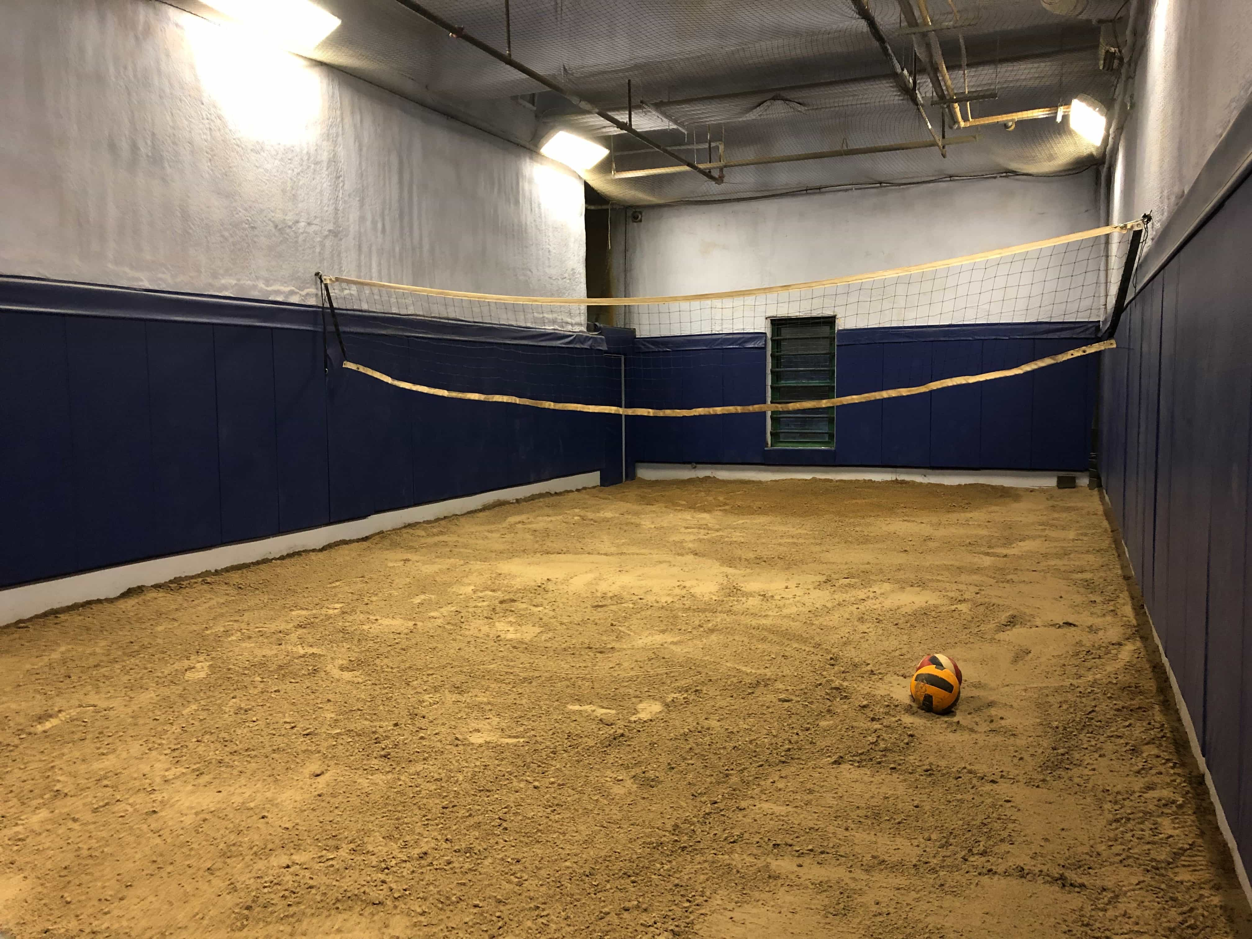 A net is strung across a dirt floor.