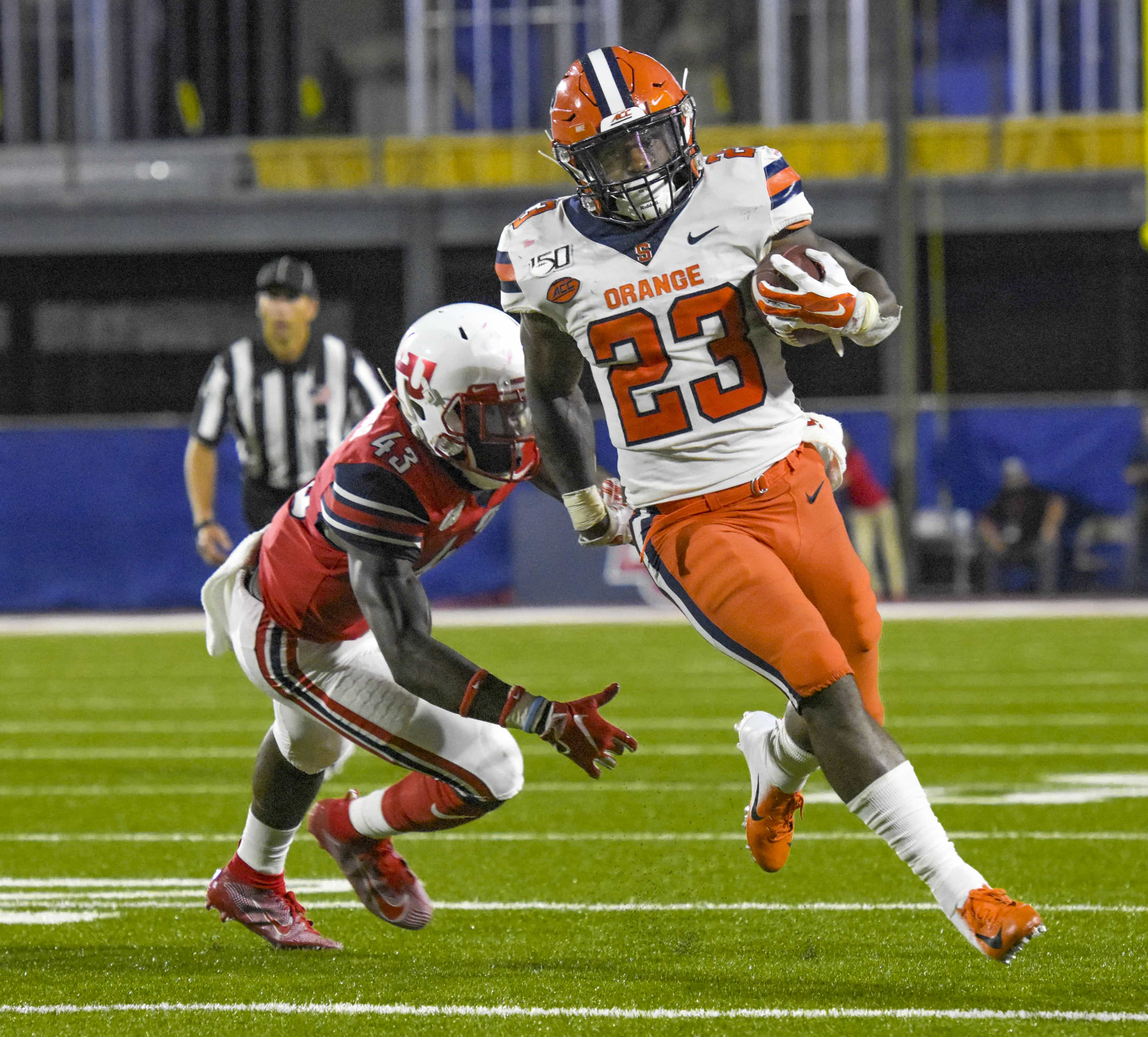 Junior running back Abdul Adams takes the ball down the field for an Orange first down against Liberty on Saturday.