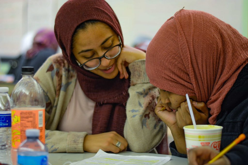 SU student Dina Eldawy tutors in the high school girls room at the Northside Learning Center.