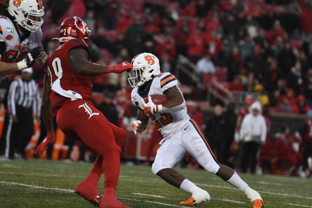 Junior running back Abdul Adams shakes a defender in the backfield against Louisville on Nov. 23, 2019.