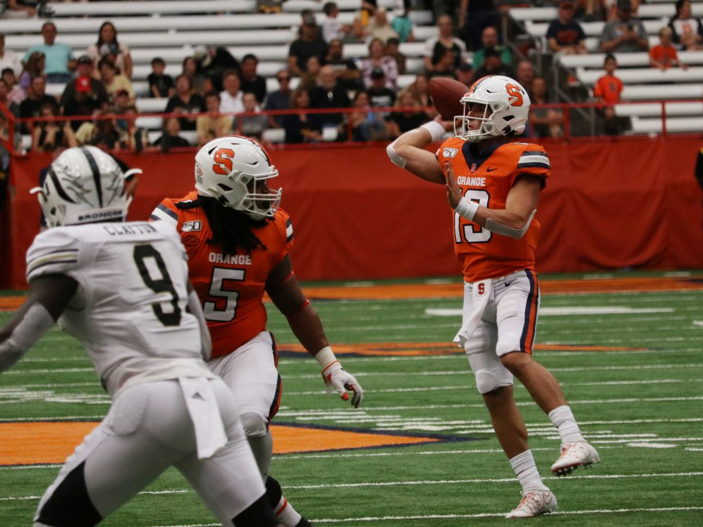 Syracuse University's quarterback Tommy DeVito (13), passes the football downfield during a football game against Western Michigan on September 21, 2019.