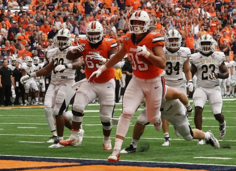 Syracuse University's tight end Aaron Hackett (89), pushes through Western Michigan University's defense for a touchdown. Syracuse University beat Western Michigan University with a score of 52-33.