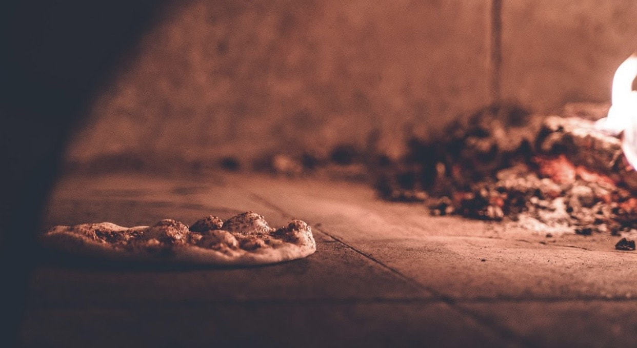 a mano will be serving wood-fired pizza with dough made in-house during Downtown Dining Weeks.