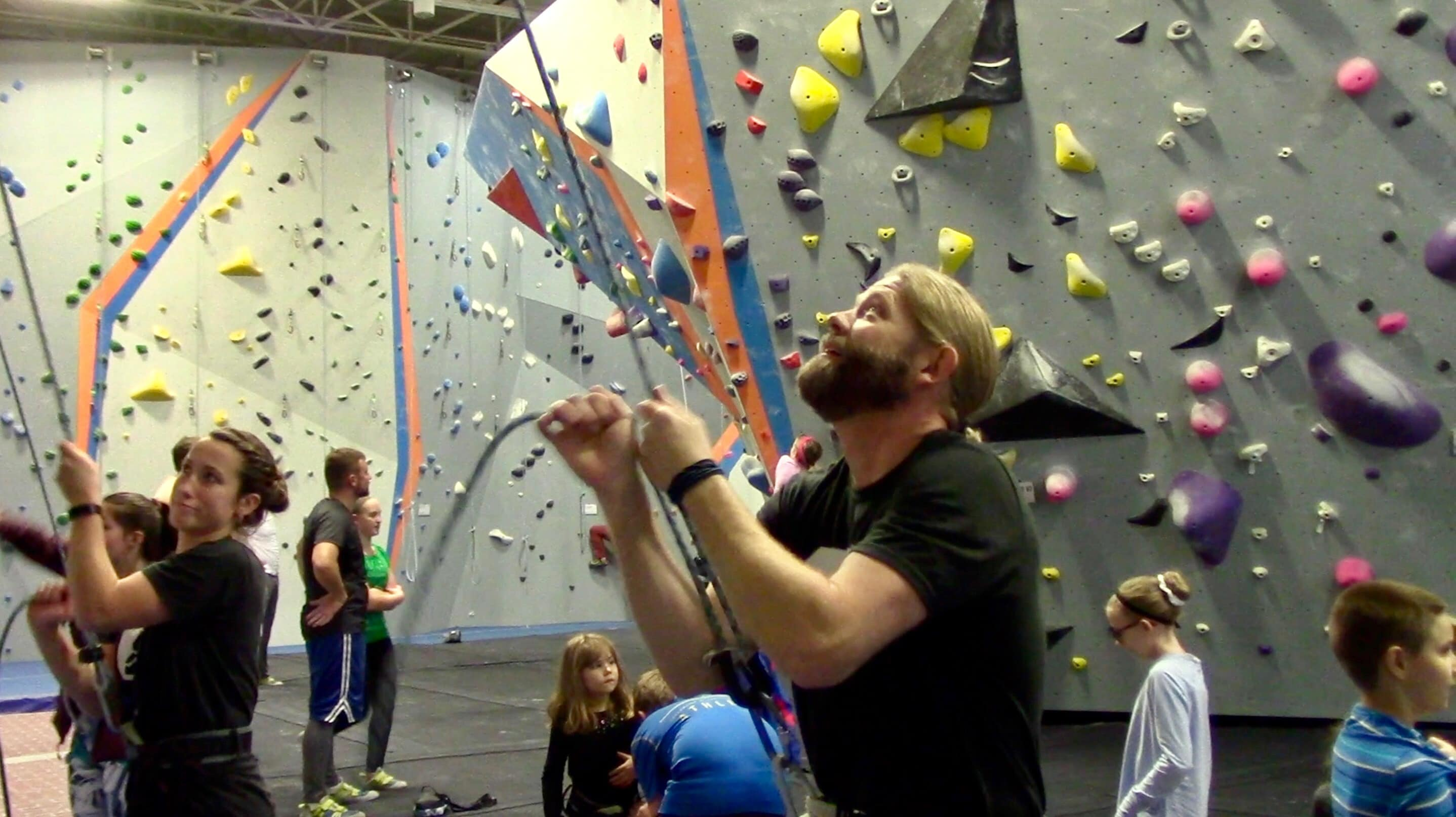 Greg Sommer instructing a rock climbing course at Syracuse's Central Rock Gym.