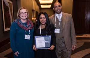 Kishauna Soljour receives The Council of Graduate Schools/ProQuest Distinguished Dissertation Award in Humanities and Fine Arts. Pictured L to R: Mary Farmer-Kaiser, Kishauna Soljour and Francois Soljour.