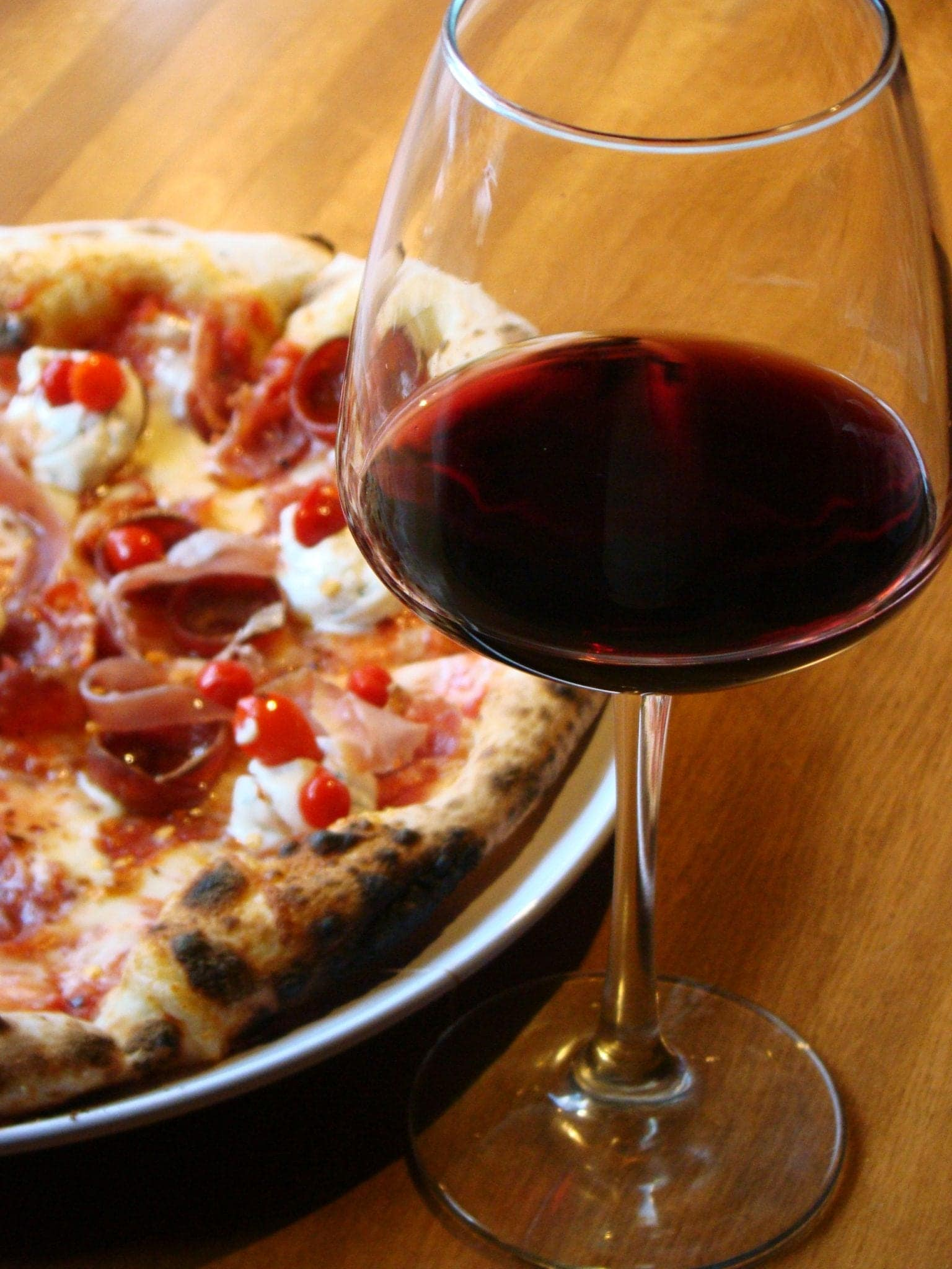 Pizza and a glass of red wine at Peppino's, soon to be Pomodoro