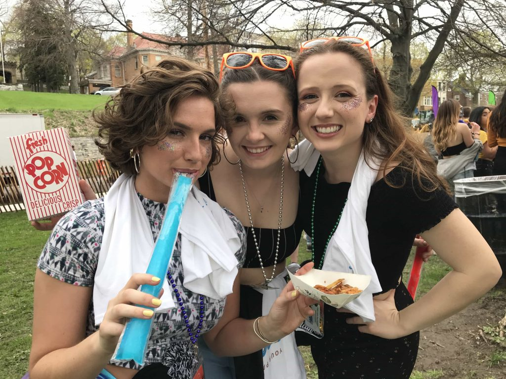 Roommates Stephanie Craven, Carly Caviglia and Kate Jarecki sport matching gliter at Mayfest.