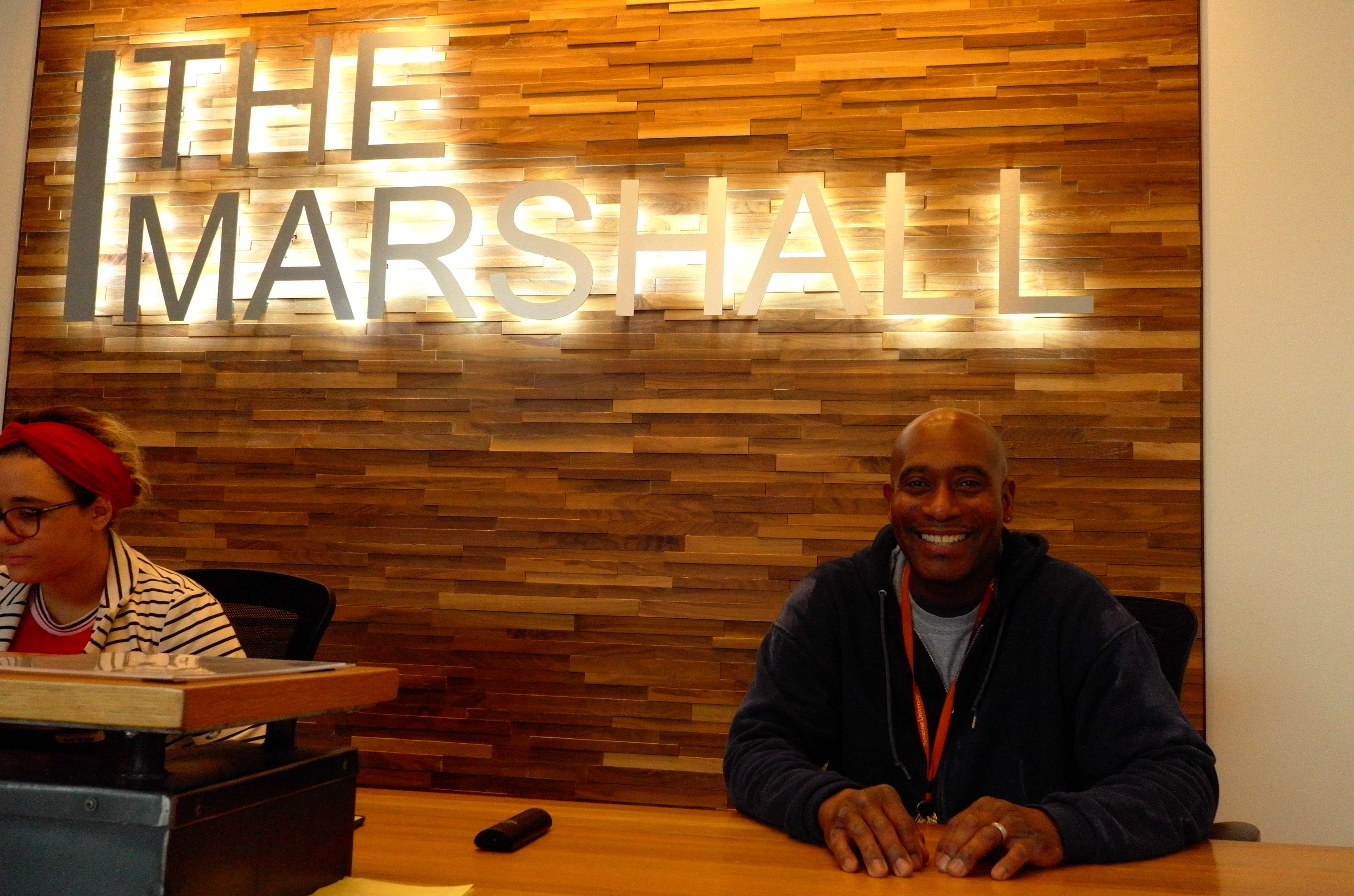 Ken Culley stands at The Marshall desk.