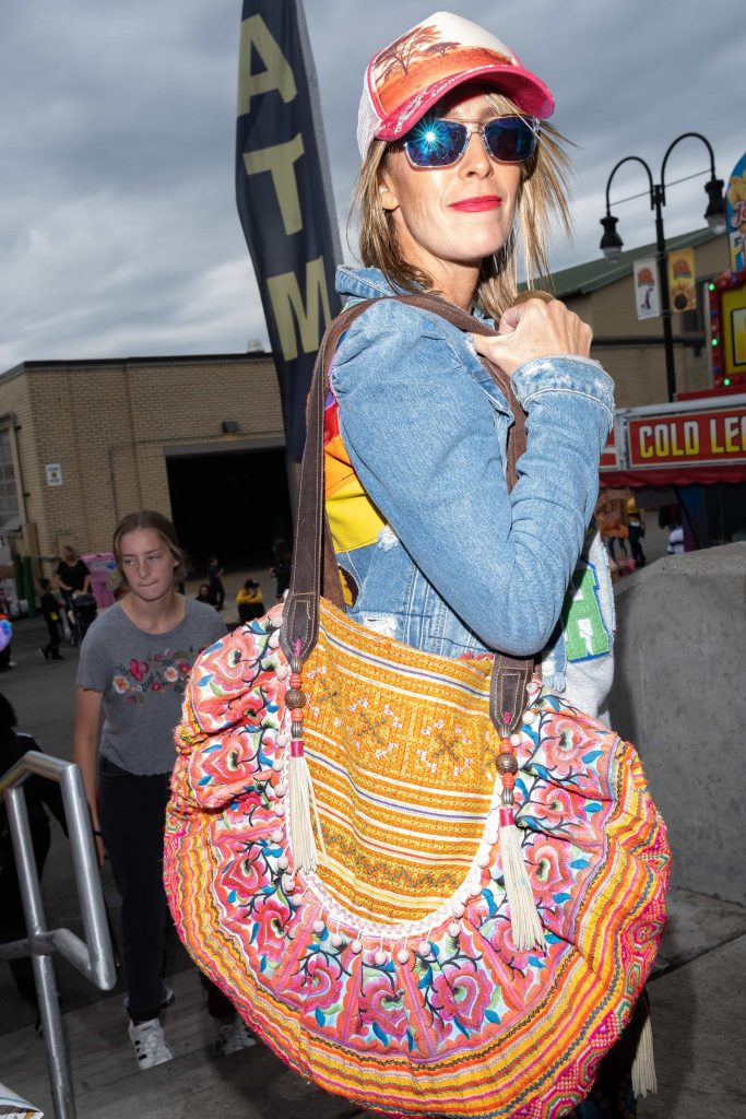 Michelle DaRin poses at the New York State Fair with her handmade clothing and bag. She will be displaying some of her collection at a local fashion exhibition in the coming weeks.