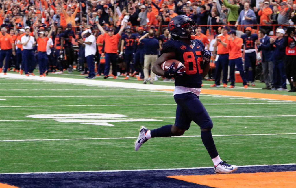 Nykeim Johnson scores Syracuse's first touchdown Saturday against NC State on an 82-yard-pass from quarterback Eric Dungey.