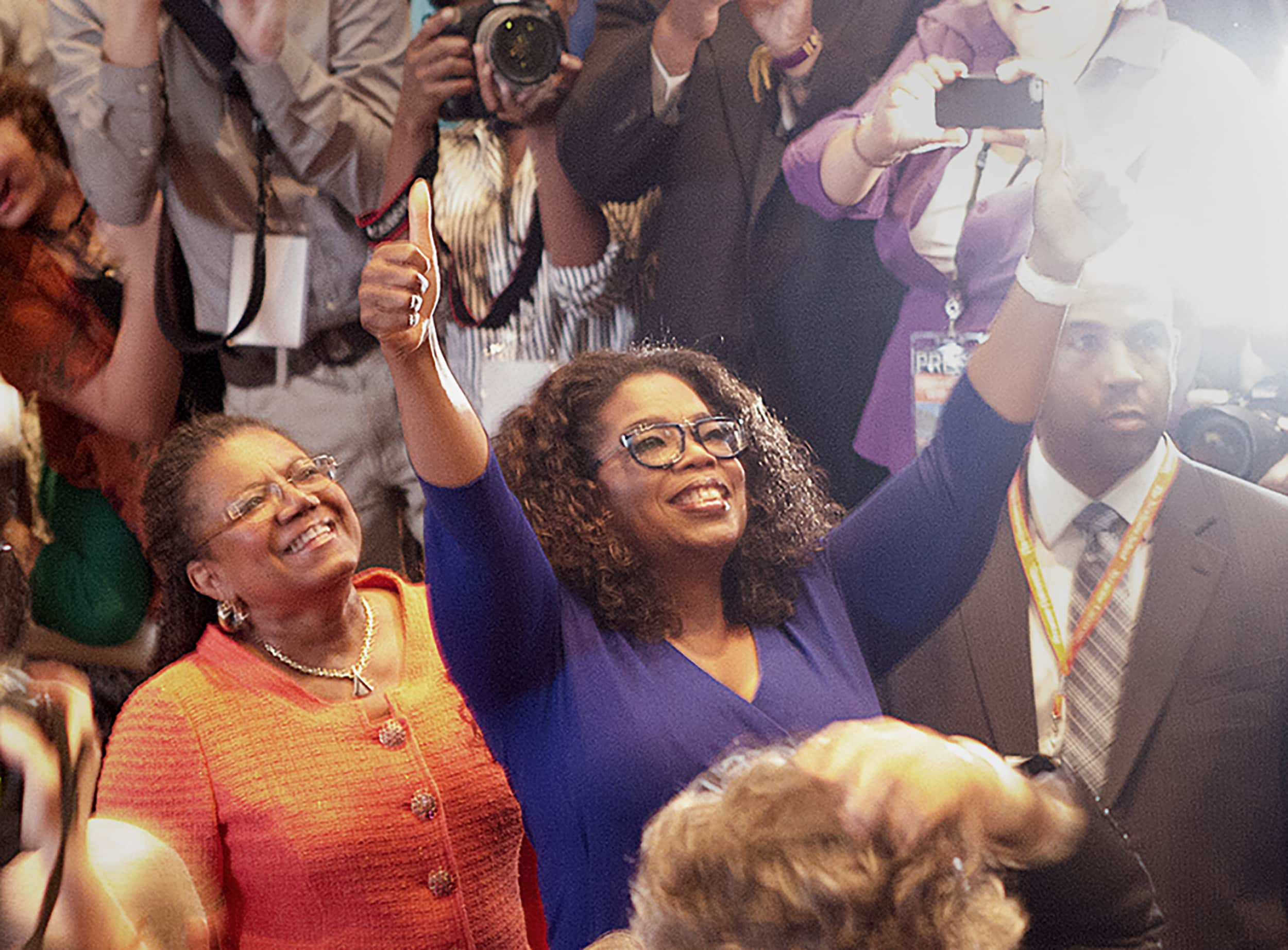 Newhouse Dean Lorraine Branham escorts special guest Oprah Winfrey into the Goldstein Auditorium in the Schine Student Center in 2014.