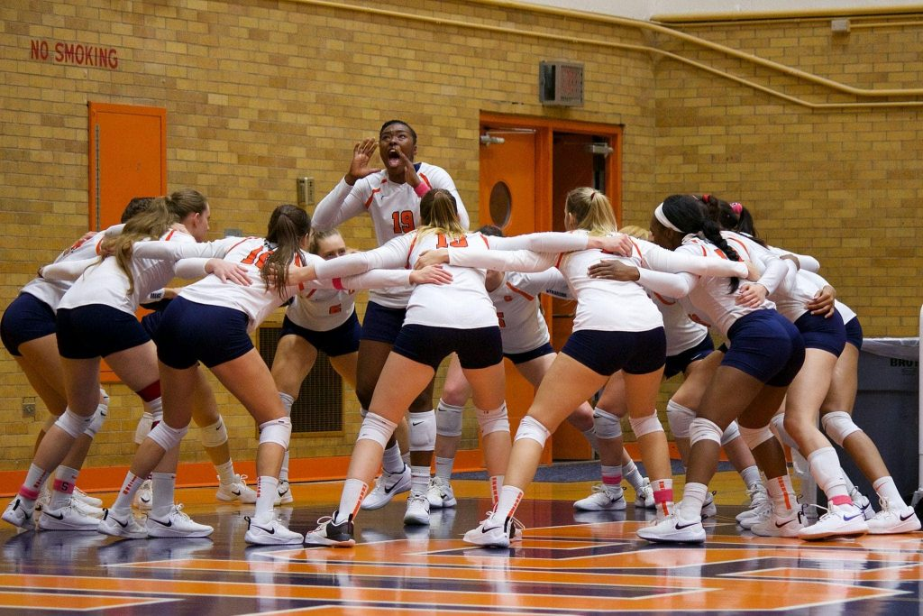 Middle blocker Santita Ebangwese leads the SU volleyball squad in a pre-game chant.