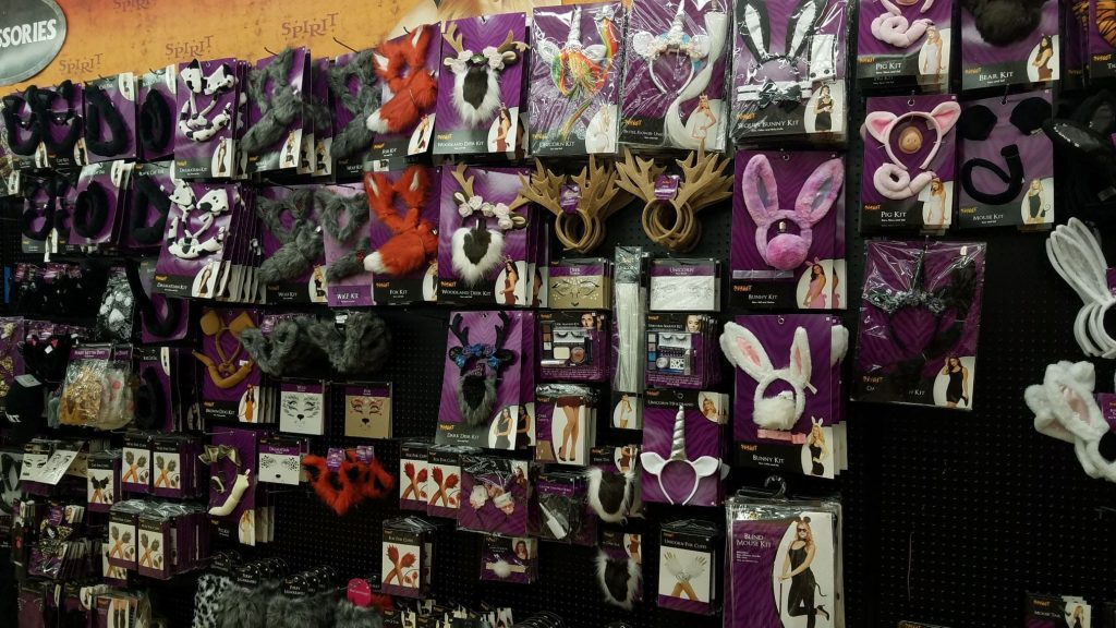 Wall of animal costume accessories at Spirit Halloween