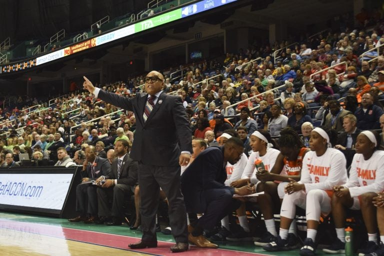 Syracuse head coach Quentin Hillsman coaches from the sidelines against Notre Dame at the ACC Women's Tournament on March 9, 2019.