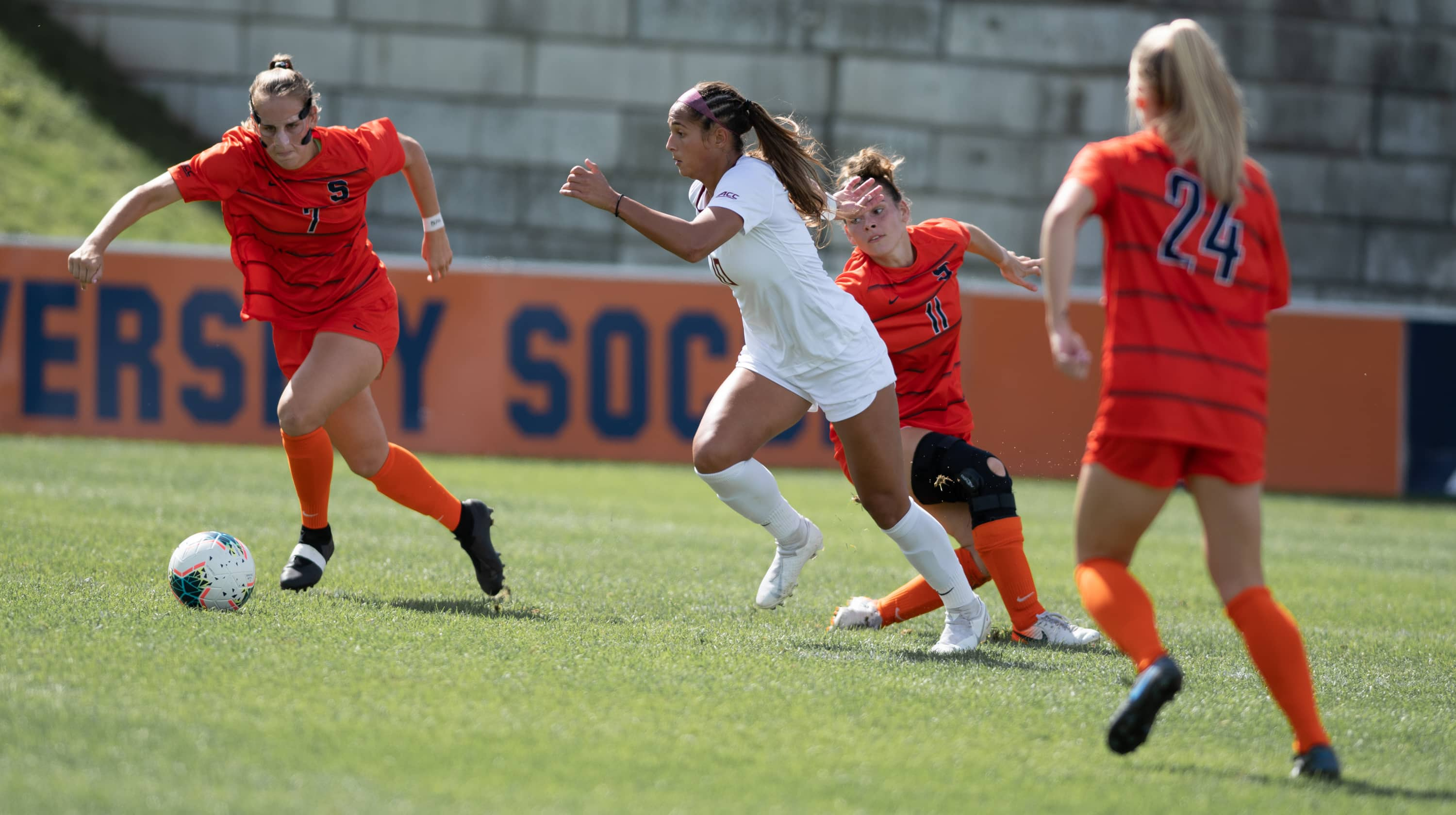 SU's Taylor Bennett (7), FSU's Deyna Castellanos (10) and SU's Jenna Tivnan (11) fight for the ball during the Sept 29 game.