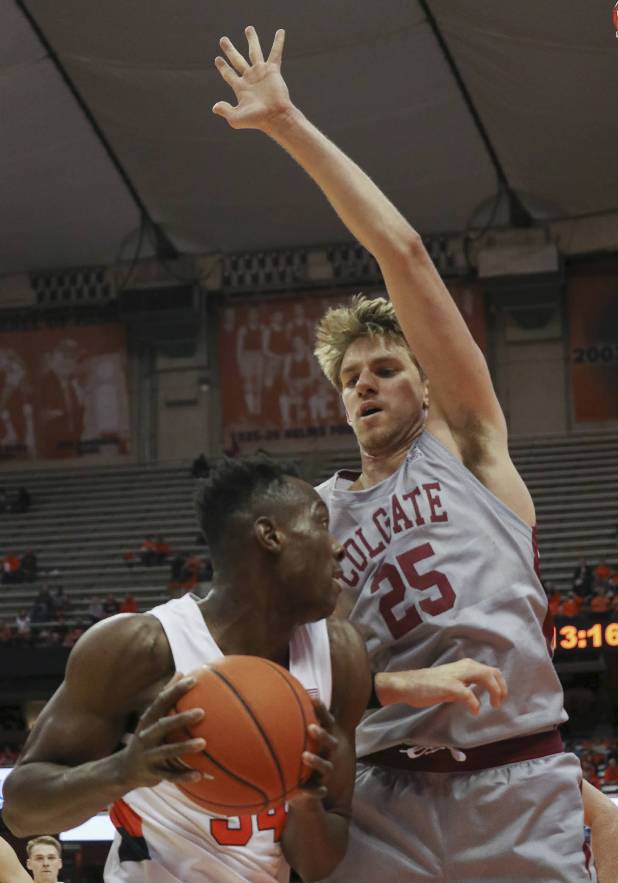 Colgate University's forward Rapolas Ivanauskas (25), attempts to block a shot from Syracuse University's forward Bourama Sidibe (34), in a college basketball game on Nov. 13, 2019. Syracuse beat Colgate with a score of 70 to 54.