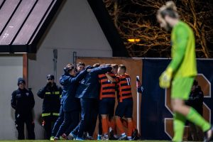 The Syracuse soccer team celebrates after scoring their third goal against Rhode Island during the first round of the NCAA Men's Soccer Tournament. Syracuse defeated Rhode Island 3-2.