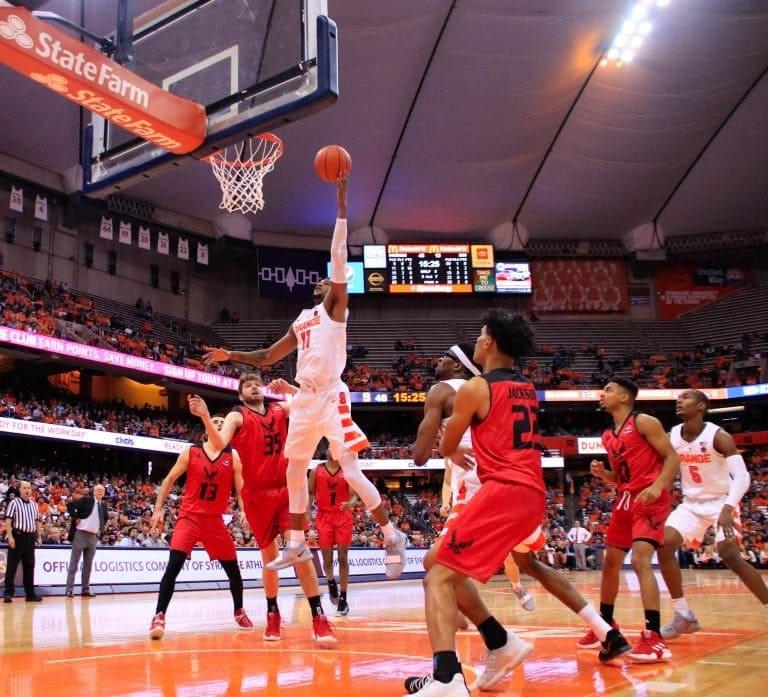 Oshae Brissett dunks over Eastern Washington opponents.