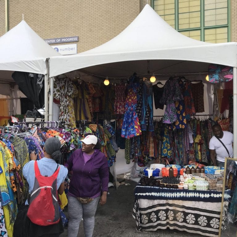 A vendor selling clothing and other items in the Pan African village at the 2019 New York State Fair.