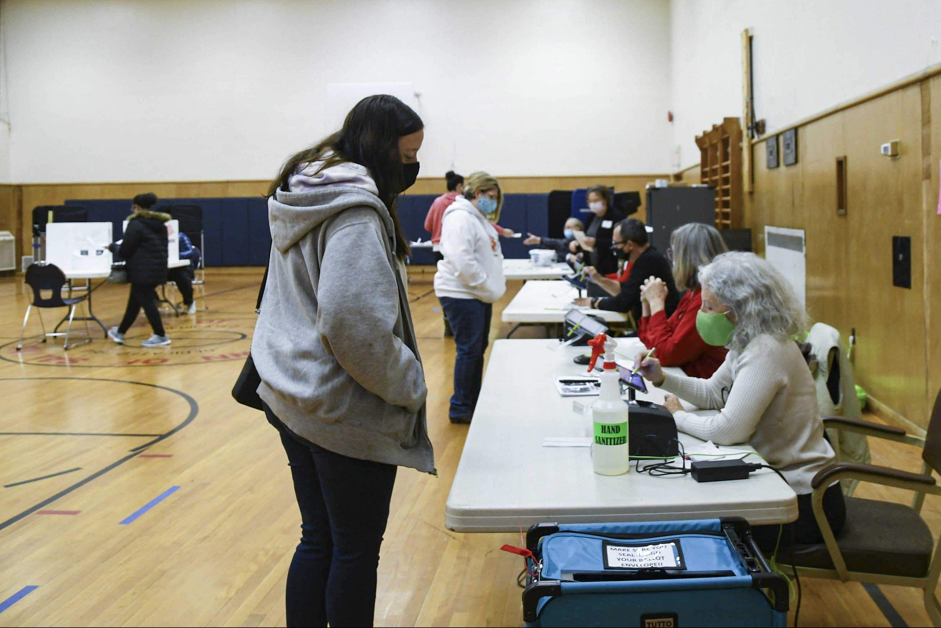 A voter checks in at the Salina Town Hall polling station before casting their ballot.