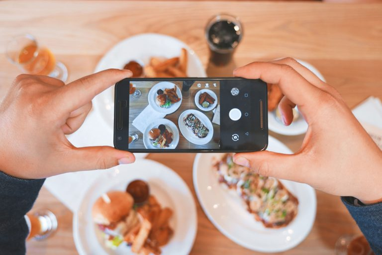 Phone taking photo of meal