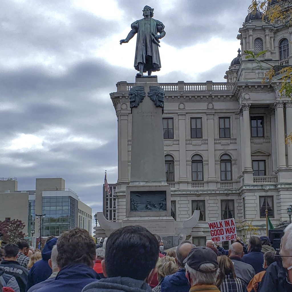 Crowds gather at Syracuse's The Columbus Statue Downtown Continues that has divided the Syracuse community as the city makes decisions on what's next