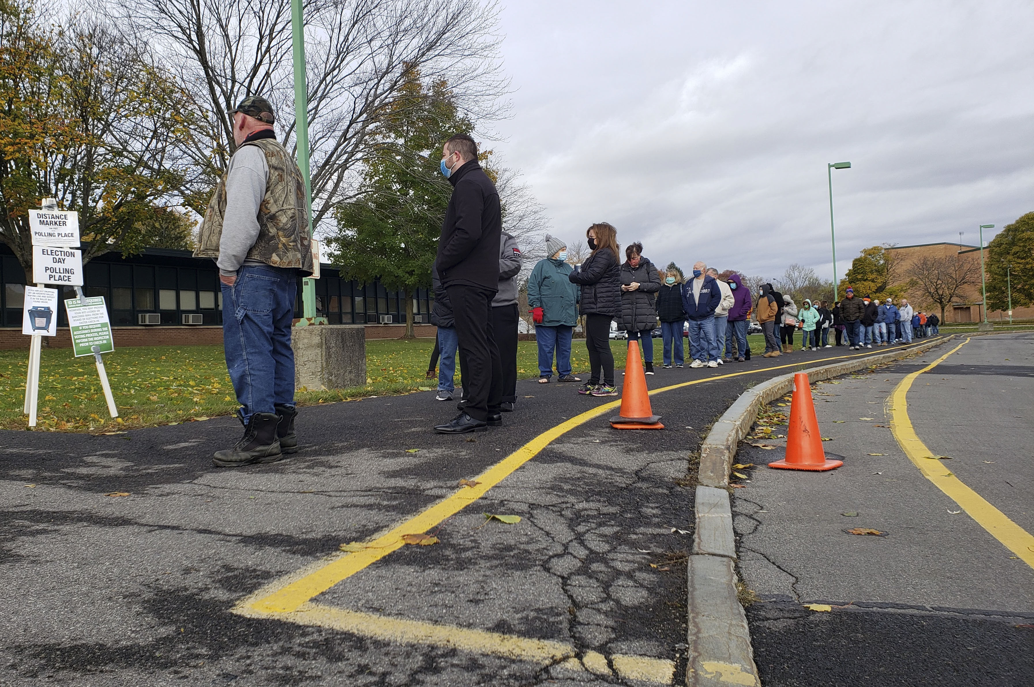 Wait times lasted about 45 minutes at the Northern Syracuse School Office this morning as voters waited patently budled and masked up.