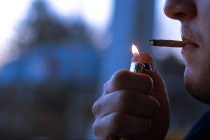 A Syracuse student smokes marijuana at their apartment.
