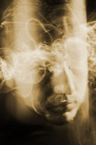 A photo illustration depicting a head surrounded by smoke.