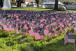 A flag garden stands outside Hendricks Chapel to honor the lives lost in the 9/11 attacks