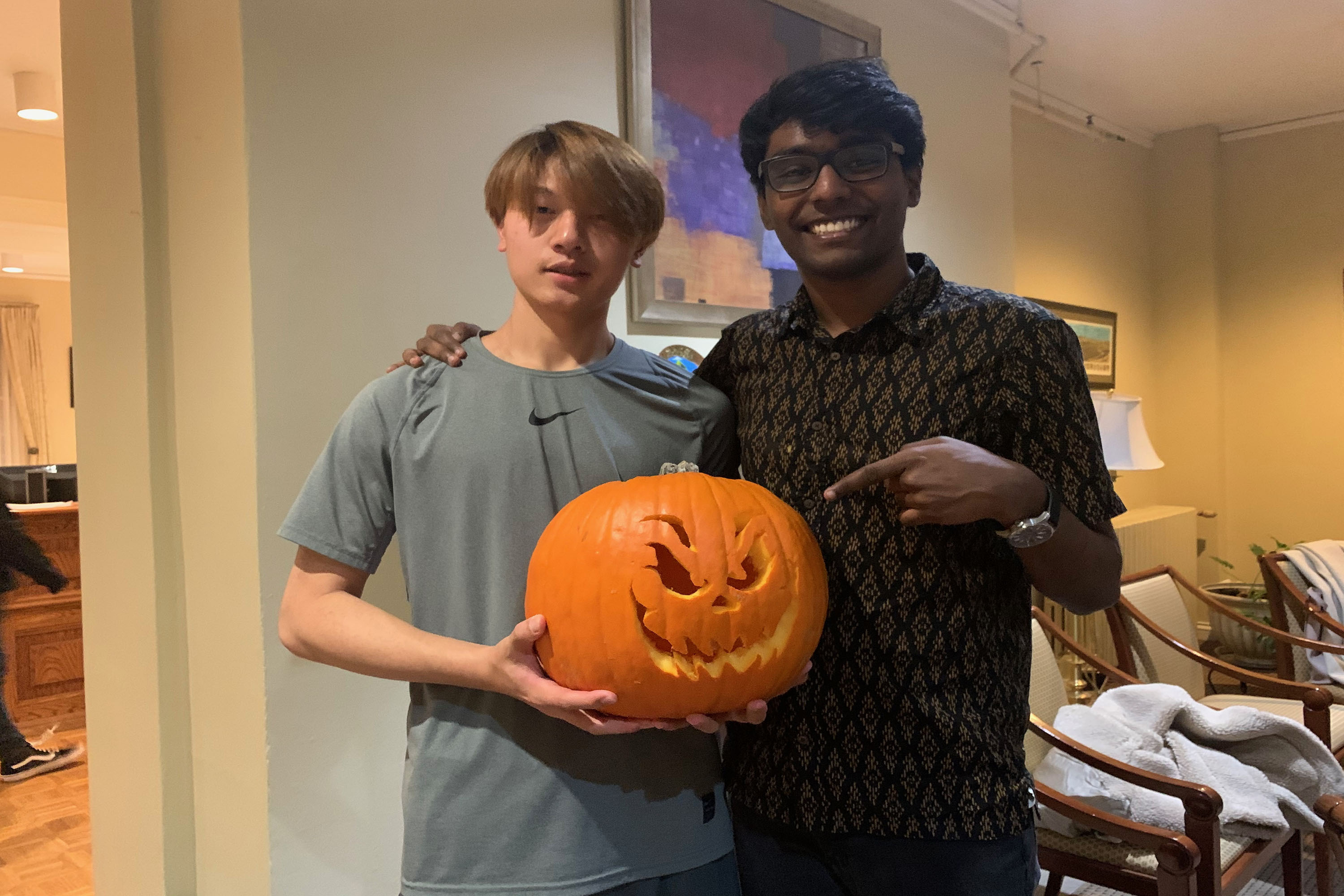 Paul and a student at a Halloween event at SU's Center for International Services in 2019.