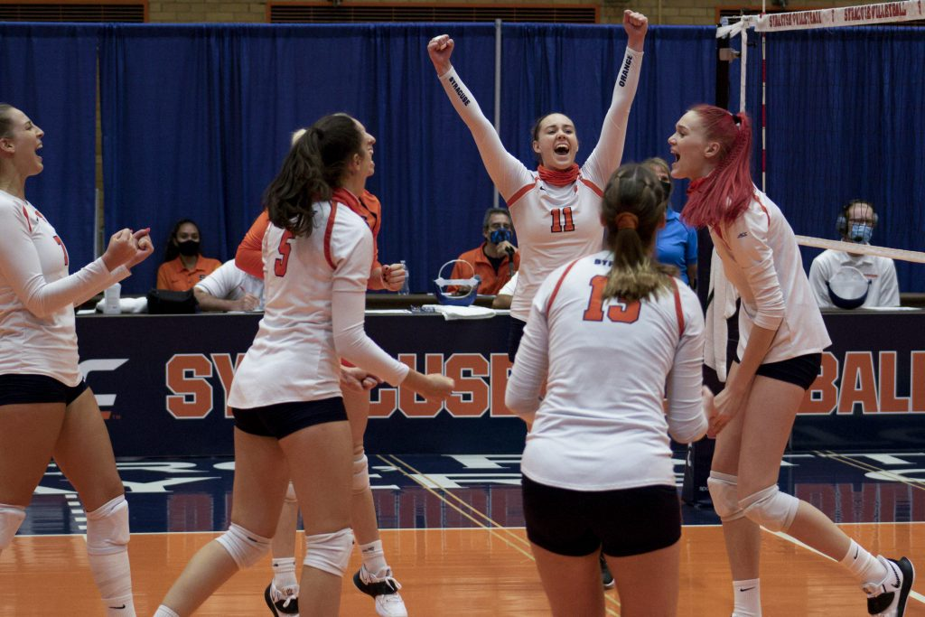 Polina Shemanova (11) and teammates celebrate during Syracuse's match on Sept. 25, 2020, vs. Pittsburgh.