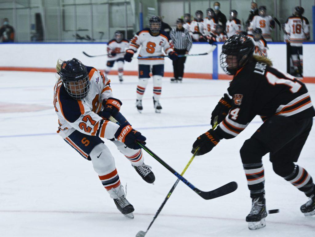 Syracuse's Victoria Kilmek takes a shot open goal around RIT's Ellie Larson.