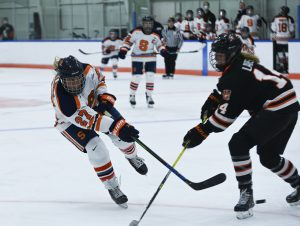 Syracuse's Victoria Kilmek takes a shot open goal around RIT's Ellie Larson.