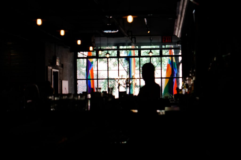 Bar interior with Gay Pride flags on display