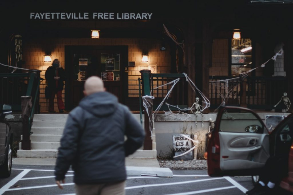 Locals enter the Fayetteville Free Library to vote on election night 2020.