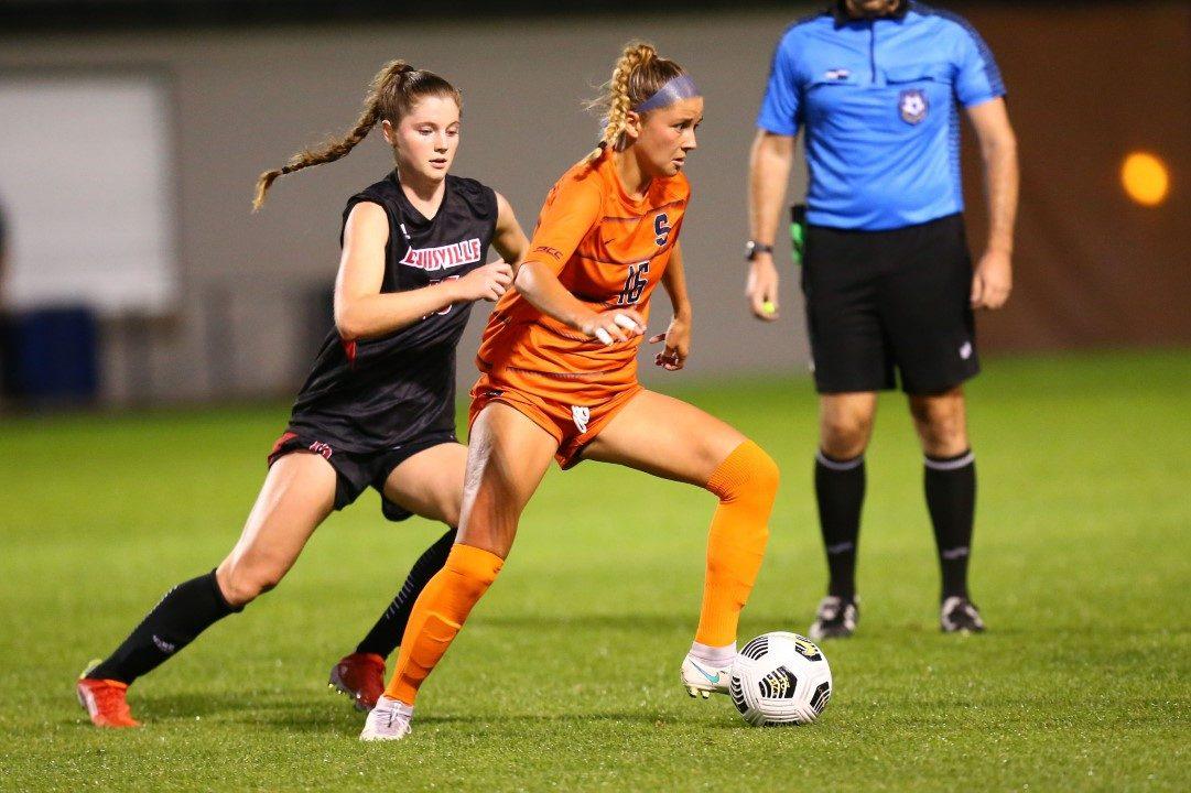 Syracuse midfielder Koby Commandant (16) escapes a Louisville Cardinals defender at SU Soccer Stadium on Thursday, Sept. 23, 2021.
