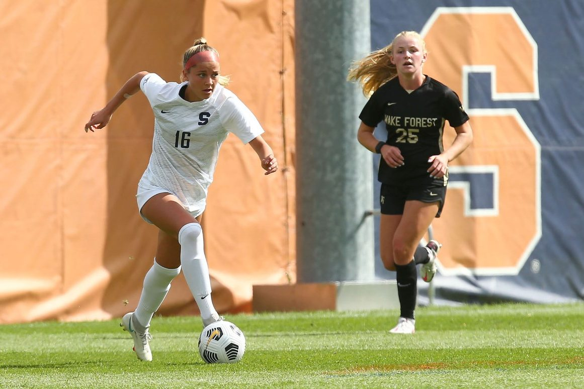 Syracuse's Koby Commandant (16) dribbles past Wake Forest's Sophie Faircloth (25) on Sunday's match at SU Soccer Stadium.